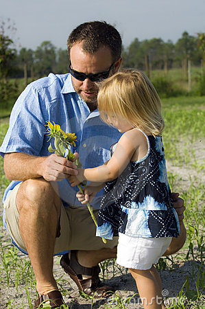 Man and girl holding flower