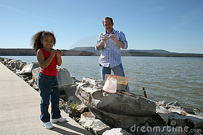 Man and girl on riverbank