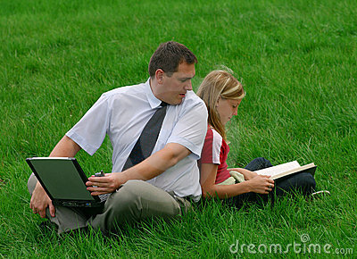 Man and girl sitting in the grass