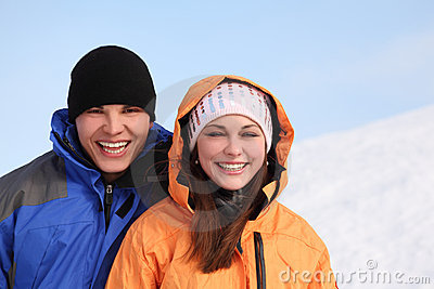 Man and girl in sport clothes standing and smiling