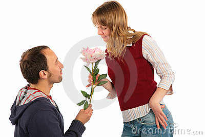 Man gives flower to  woman