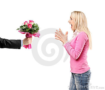 Man giving a bunch of flowers and surprised woman