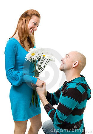 Man giving camomile to woman