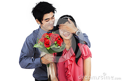 A man giving flowers to woman