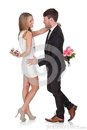 Man giving fresh flowers to woman
