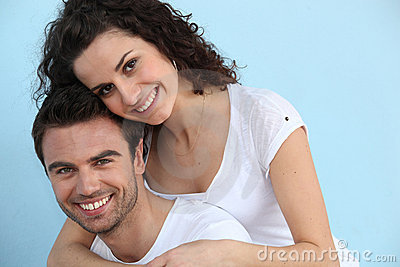 Man giving girlfriend piggy-back
