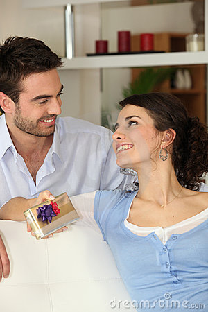 Man giving his girlfriend present