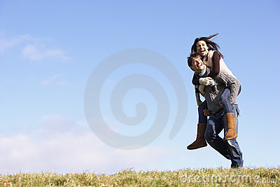 Man Giving His Wife A Piggy Back Ride