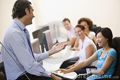 Man giving lecture in computer class