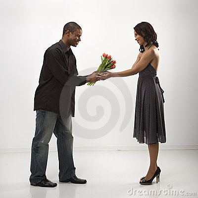 Free Man Giving Woman Flowers. Stock Photography - 2425422