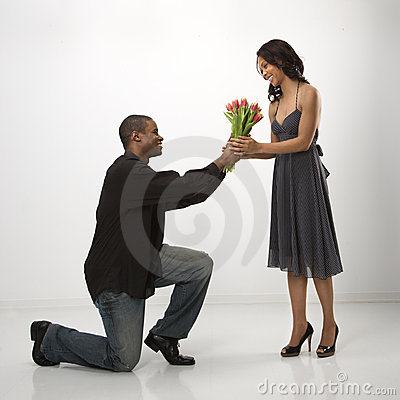 Free Man Giving Woman Flowers. Stock Images - 2425424