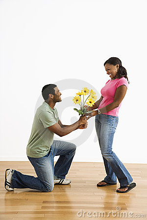 Man giving woman flowers.