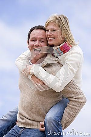 Free Man Giving Woman Piggyback Ride Outdoors Smiling Royalty Free Stock Photo - 5937605