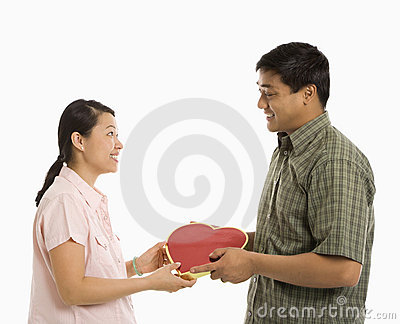 Man giving woman present.