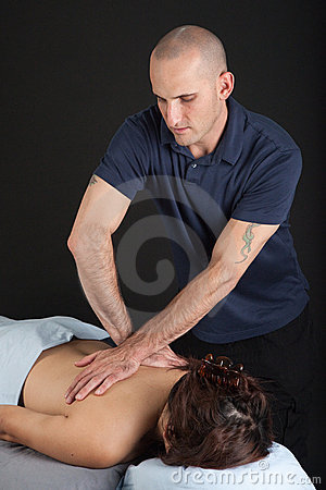 Man giving woman a professional massage