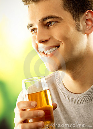 Man with glass of fruit juice