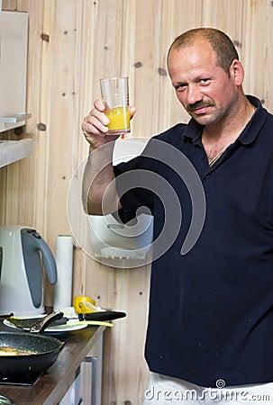 Man with glass of orange juice