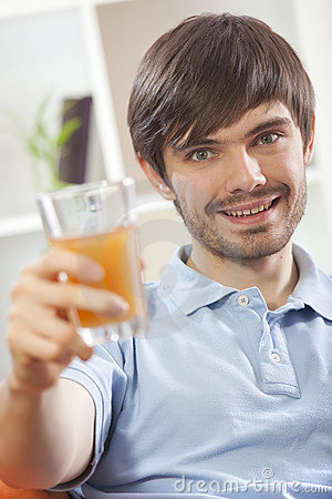 Man with glass orange juice
