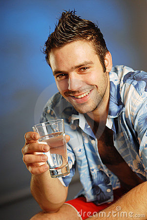 A man with a glass of water