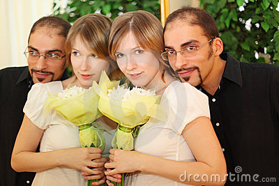 Man in glasses and beauty blond girl with flowers