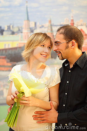 Man in glasses embracing beauty blond girl
