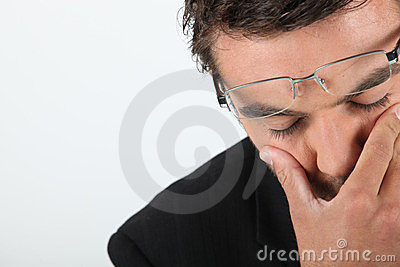 Man in glasses expressing dread