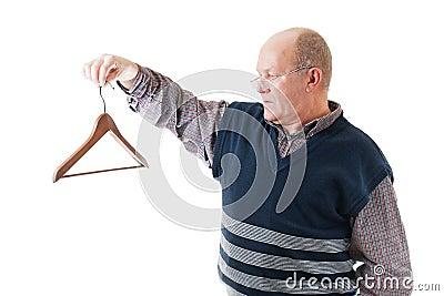 Man in glasses holds cloth hanger