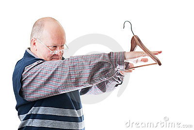 Man in glasses measures cloth hanger