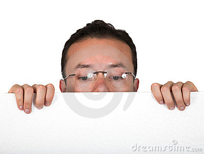 Man with glasses peeping over white card