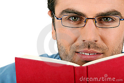 Man with glasses reading book