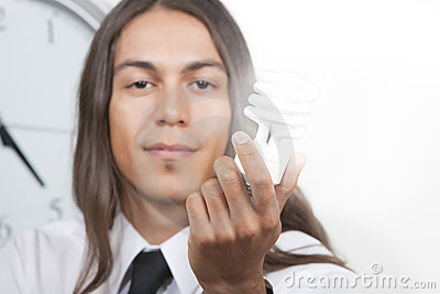 Man with glowing energy efficient lightbulb