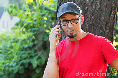 Man with goatee talking on cell phone