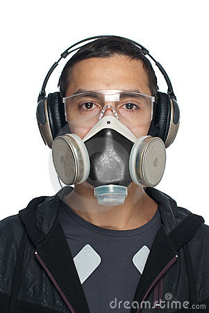 Man in Goggles, Respirator and headphones
