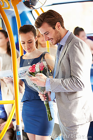 Man Going To Date On Bus Holding Bunch Of Flowers