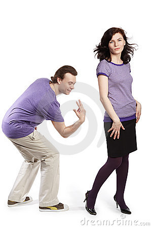 Man going to smack with fingers on back of woman Stock Photo