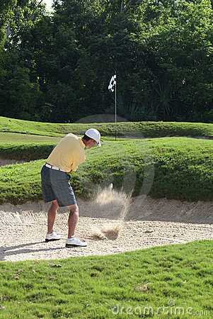 Man Golfing from Sand Bunker