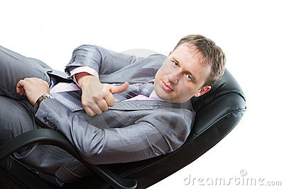 Man in gray business suit shows positive
