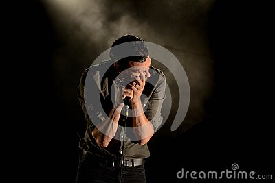 Man In Gray Dress Shirt Holding Mic In Dark Room Free Public Domain Cc0 Image