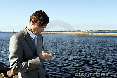 Man in a gray suit dials the phone