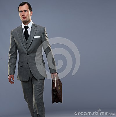 Man in grey suit walking