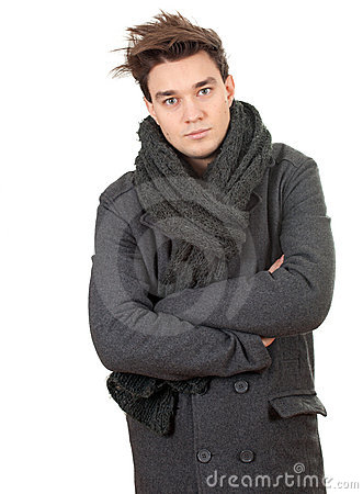 Man in grey winter coat and scarf