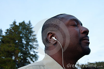 Man Grooving To The Music Wearing Earbuds