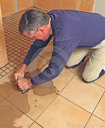 Man grouting a ceramic tile floor