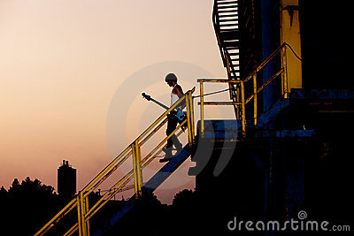 Man with guitar at dusk