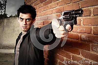 Man with gun in an alley
