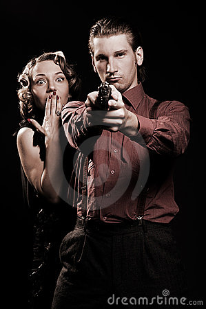 Man with gun protecting his woman