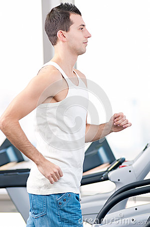 Man at the gym exercising. Run.