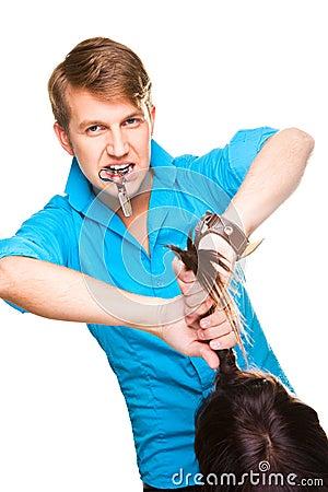 Man hairdresser working with scissors