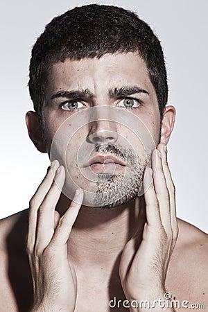 Man is half shaved posing