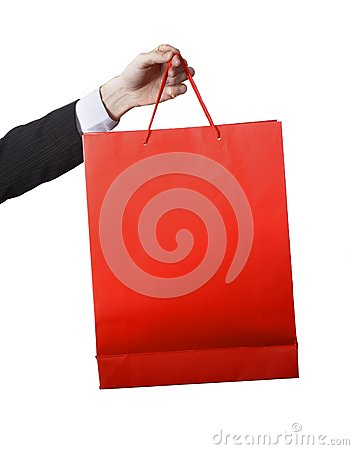Free Man Hand Carrying And Showing A Red  Shopping Bag Royalty Free Stock Images - 42998819